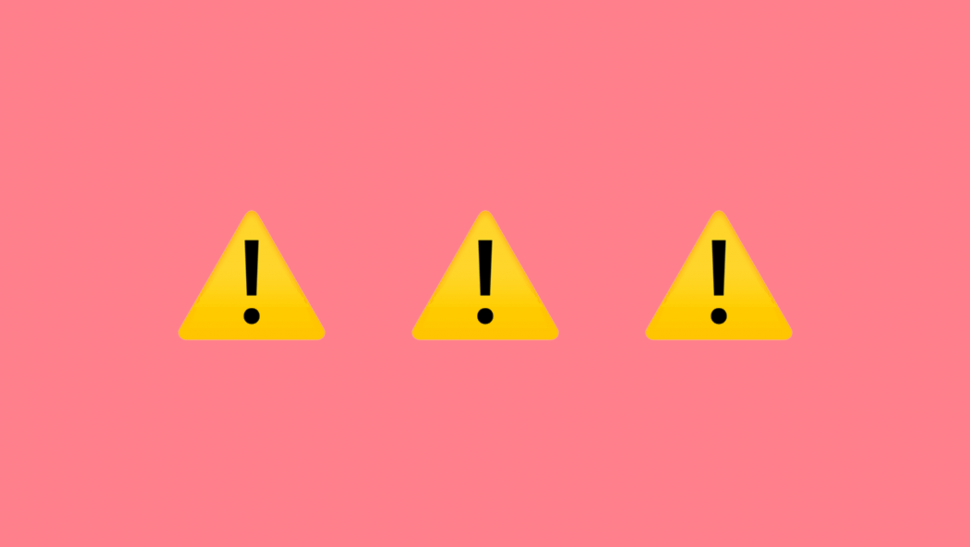 Caution on pink background.