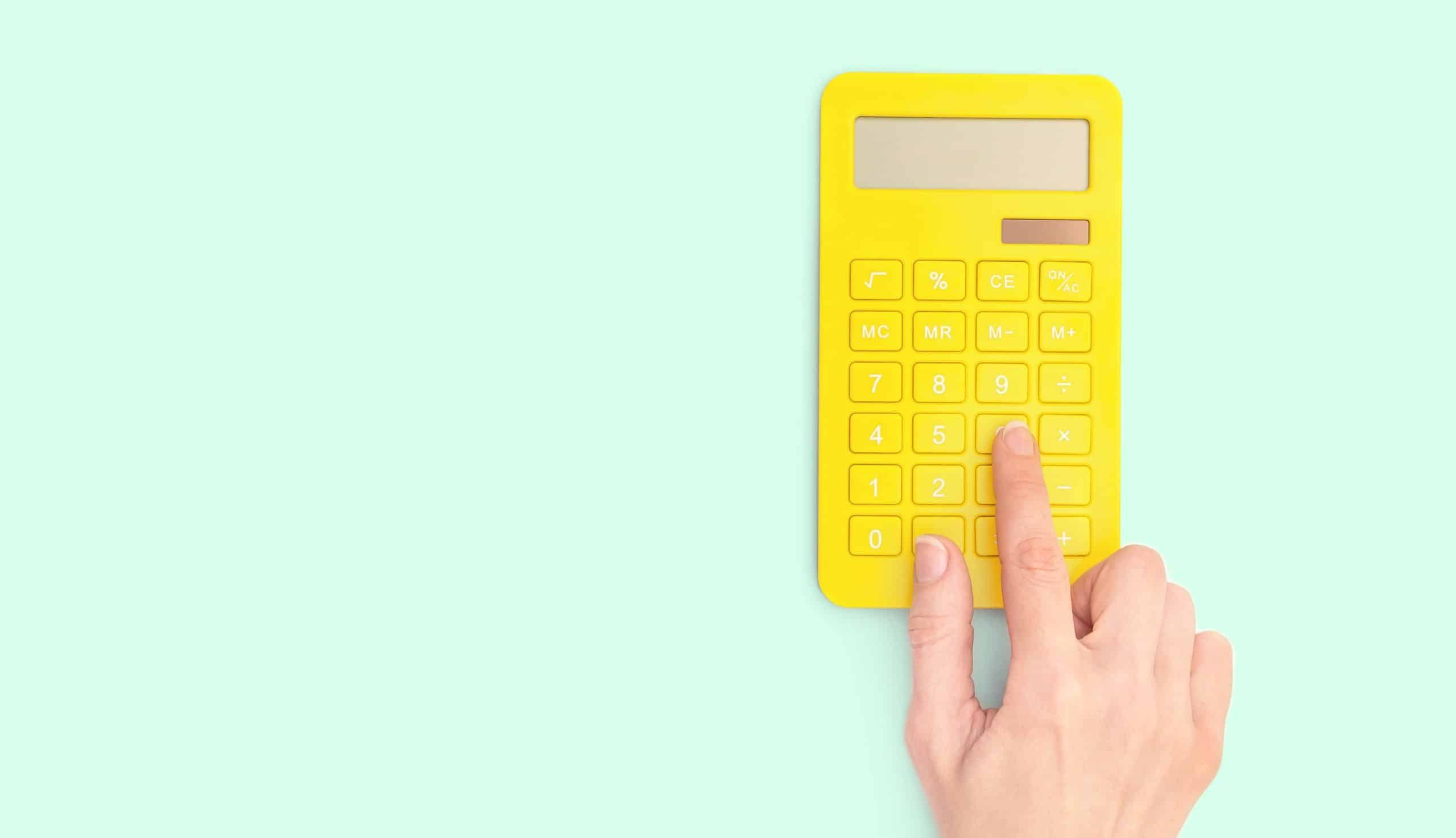 yellow calculator on green background