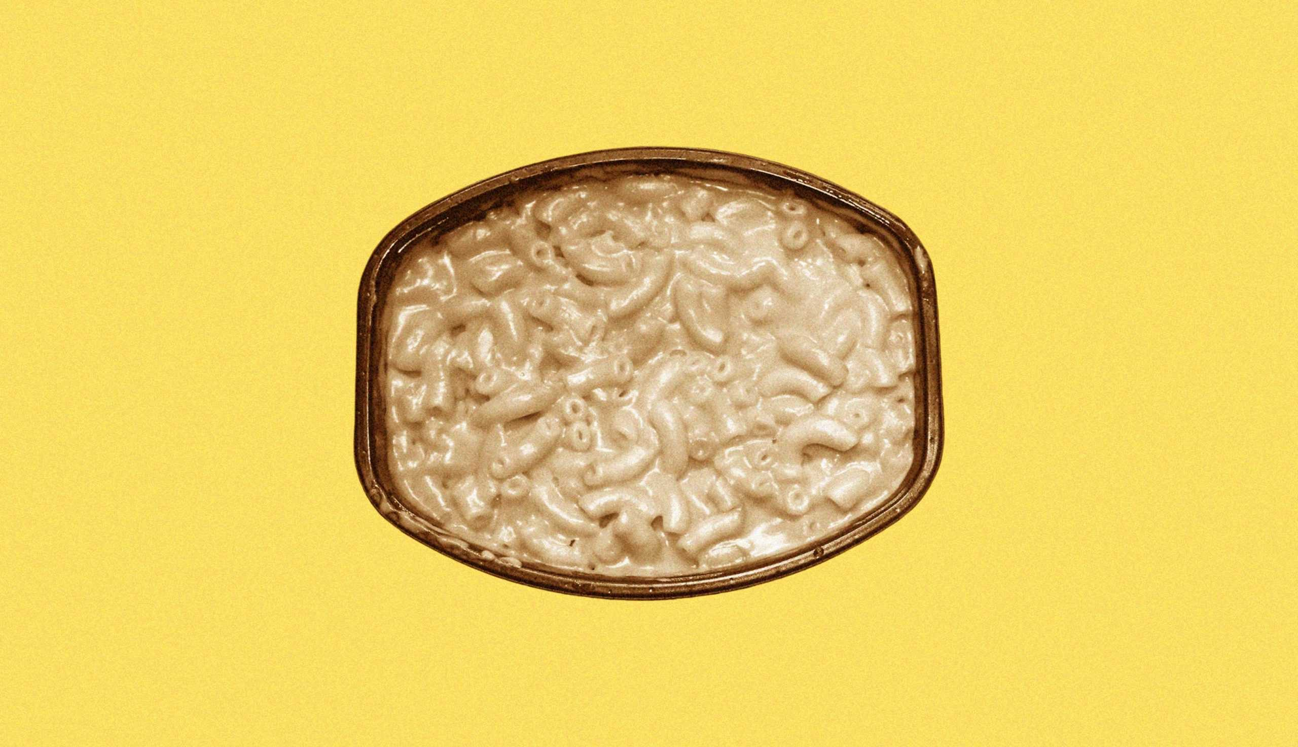 mac and cheese on yellow background.