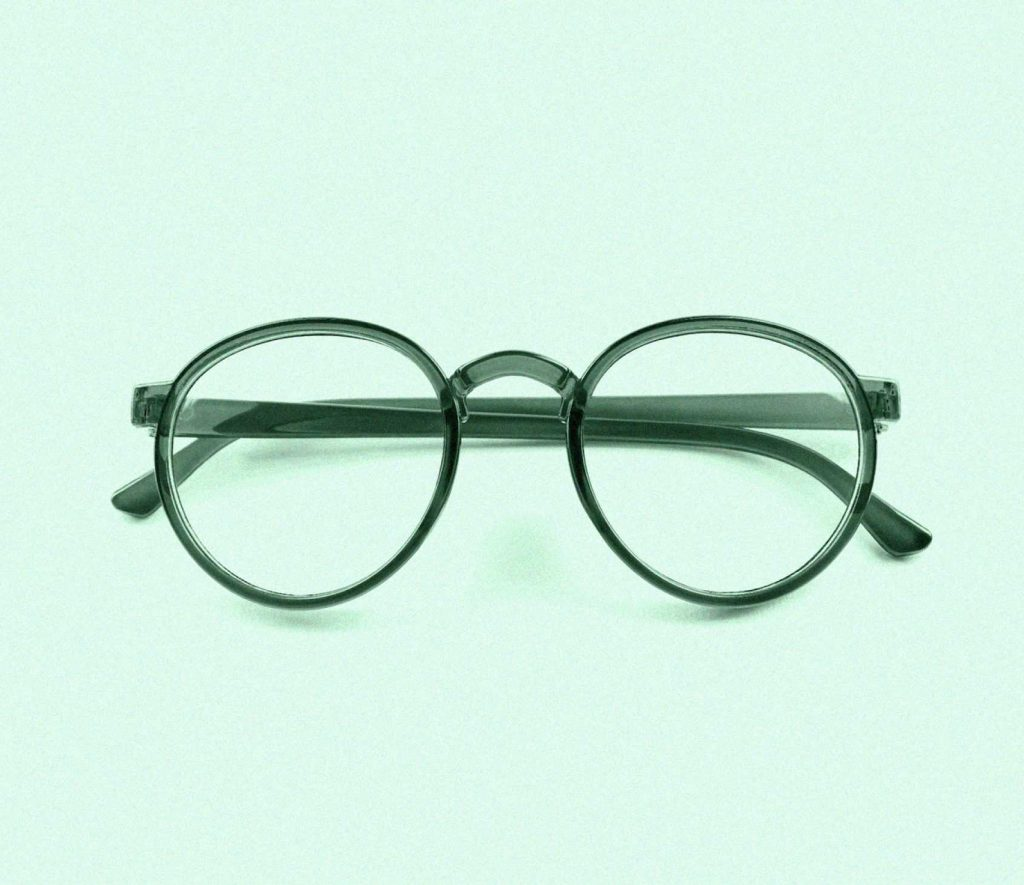 green glasses on green background