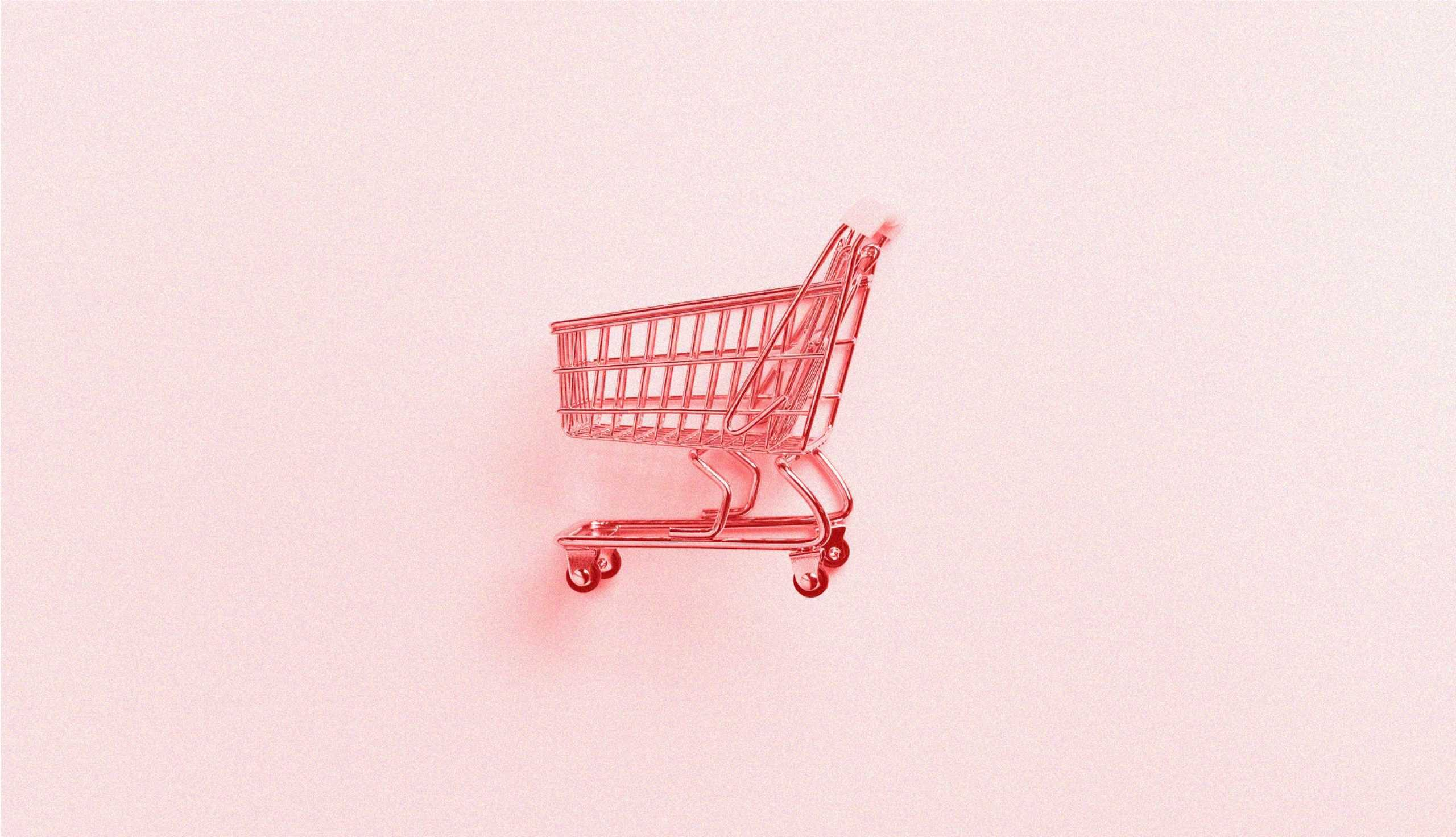 pink grocery cart on pink background