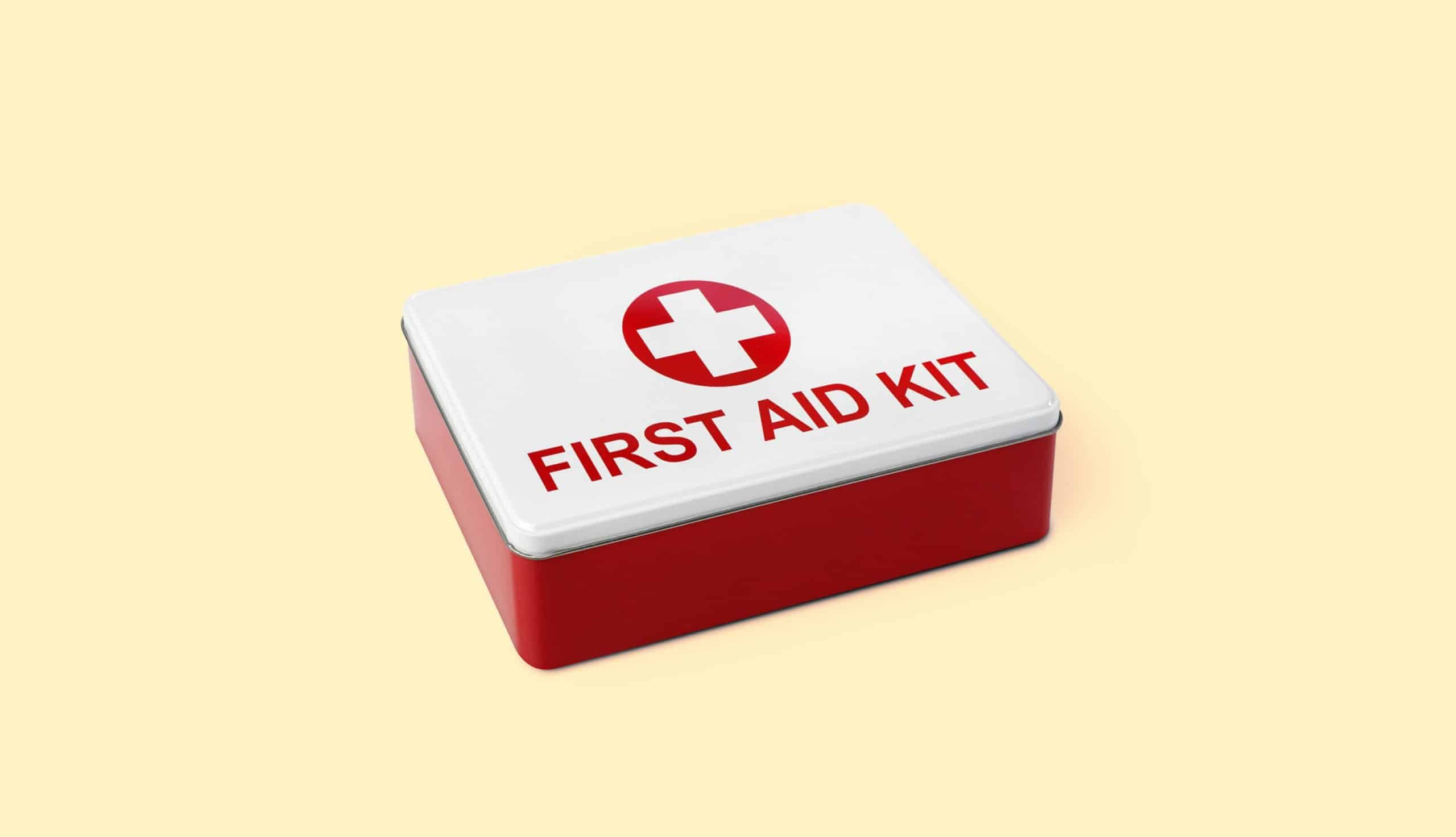 first aid kit on yellow background