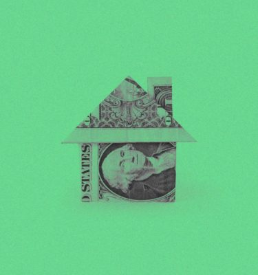 house made of money on a green background