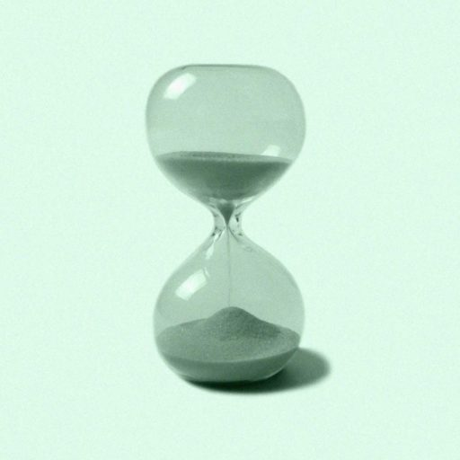 green hourglass on green background