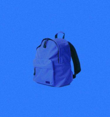 Blue backpack on blue background